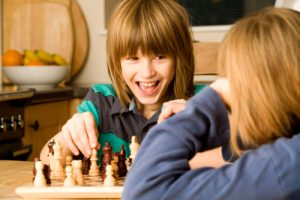 two-boys-playing-chess