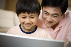 father-and-son-using-laptop
