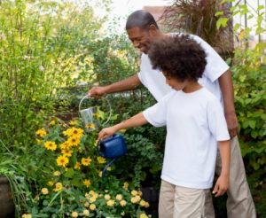 father-and-son-watering-plants