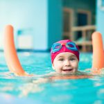 Girl-with-pool-noodle-and-bathing-cap