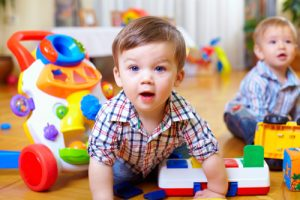 blue-eyed-baby-boy-with-toys