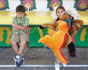 two-boys-with-carnival-toys