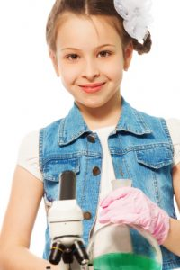 Young-girl-in-denim-vest-with-microscope