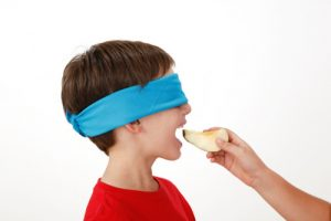 blindfold-boy-eating-a-banana