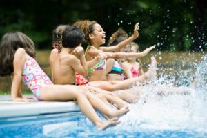 group-of-girls-splashing-at-pool
