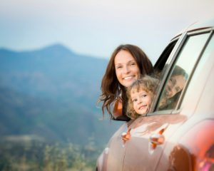 mom-and-baby-leaning-out-car-window