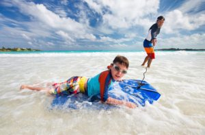 young-boy-riding-boogie-board