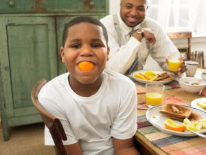 boy-with-orange-in-his-mouth
