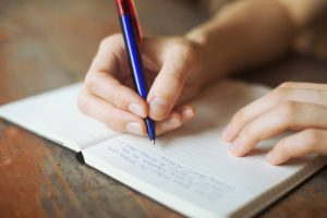 child-writing-in-journal