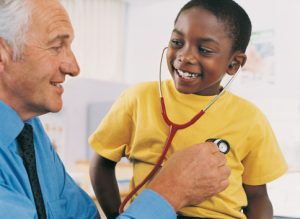 doctor-examining-young-boy-with-stethoscope
