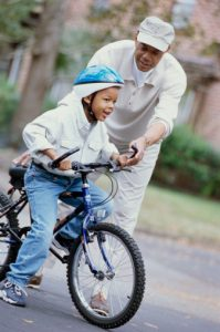 grandfather-teaching-grandson-to-ride-a-bike