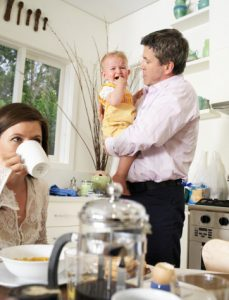 couple-in-kitchen-dad-holding-crying-baby