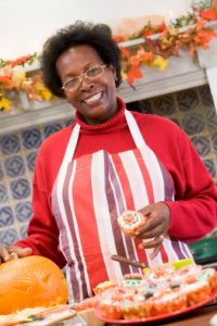woman-wearing-apron-smiling-making-halloween-treats
