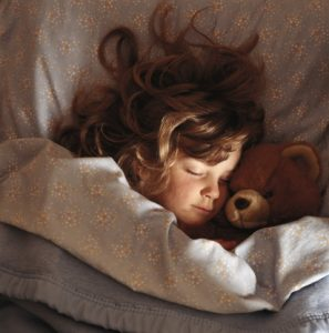 young-girl-sleeping-with-teddy-bear