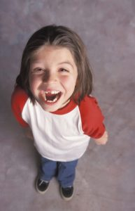 little-girl-laughing-with-missing-teeth