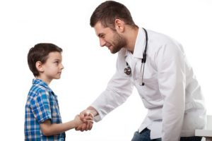 young-boyshaking-doctors-hand