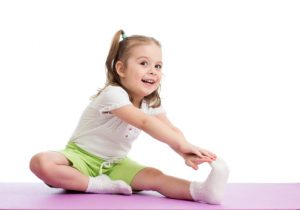 young-girl-stretching-smiling