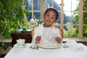 young-girl-good-manners-at-table