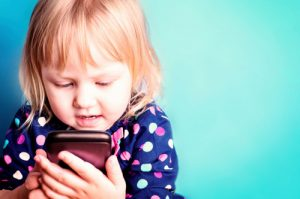 toddler-girl-with-cellphone-app