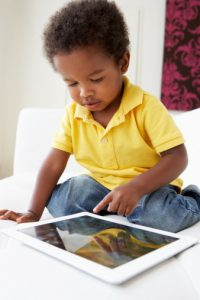 happy-toddler-playing-with-tablet-app