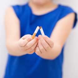 young-girl-breaking-cigarette