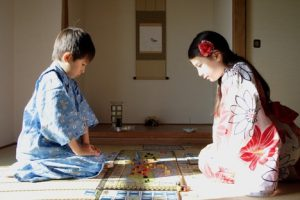 young-girl-and-boy-kneeling-playing-board-games