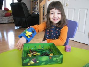 young-girl-playing-board-game
