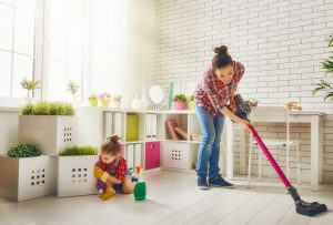 mom-sweeping-floor-little-girl-wiping-blocks
