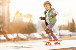 little-boy-skateboarding-wearing-helmet
