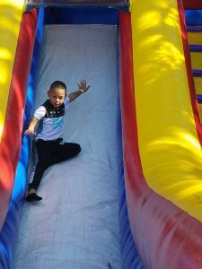 young-boy-sliding-down-bouncy-house