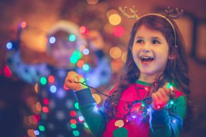 little-girl-wrapped-in-christmas-lights