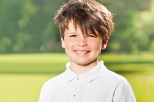 young-boy-wearing-a-polo-shirt-and-smiling