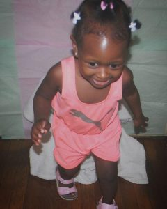 baby-girl-smiling-and-standing