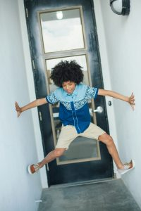 young-boy-jumping-in-hallway